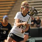 Colorado freshman Johnna Fusco heads down the field with the ball during the University of Colorado and Regis University game on Saturday, Feb. 22, 2014 at Folsom Field in Boulder, Colo. Colorado won the game with a final score of 13-10. (Maddie Shumway/CU Independent)