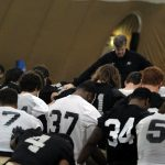 Head coach Mike MacIntyre leads a prayer at the end of practice on March 7, 2014. (Matt Sisneros/CU Independent)