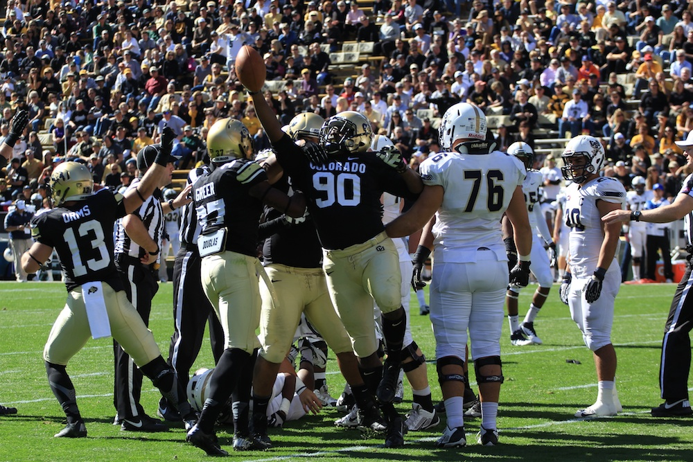 De'jon Wilson (90) recovers a fumble after defensive end, Chidera Uzo-Diribe forced a fumble against Charleston Southern, October 19, 2013 in Boulder, Colo. (Nigel Amstock/CU Independent)