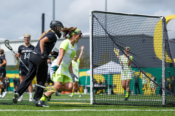 Oregon midfielder Carly O'Connell (12) celebrates after scoring the game tying goal, sending the game into overtime. The Oregon Ducks play the Colorado Buffalos  at Papé Field in Eugene, Ore., on April 27, 2014. (Michael Shaw/Emerald)