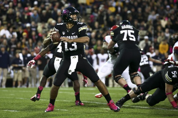 Freshman quarterback Sefo Liufau (13) drops back to pass during a game between Colorado and Arizona at Folsom Field, Oct. 26, 2013. (Kai Casey/CU Independent)