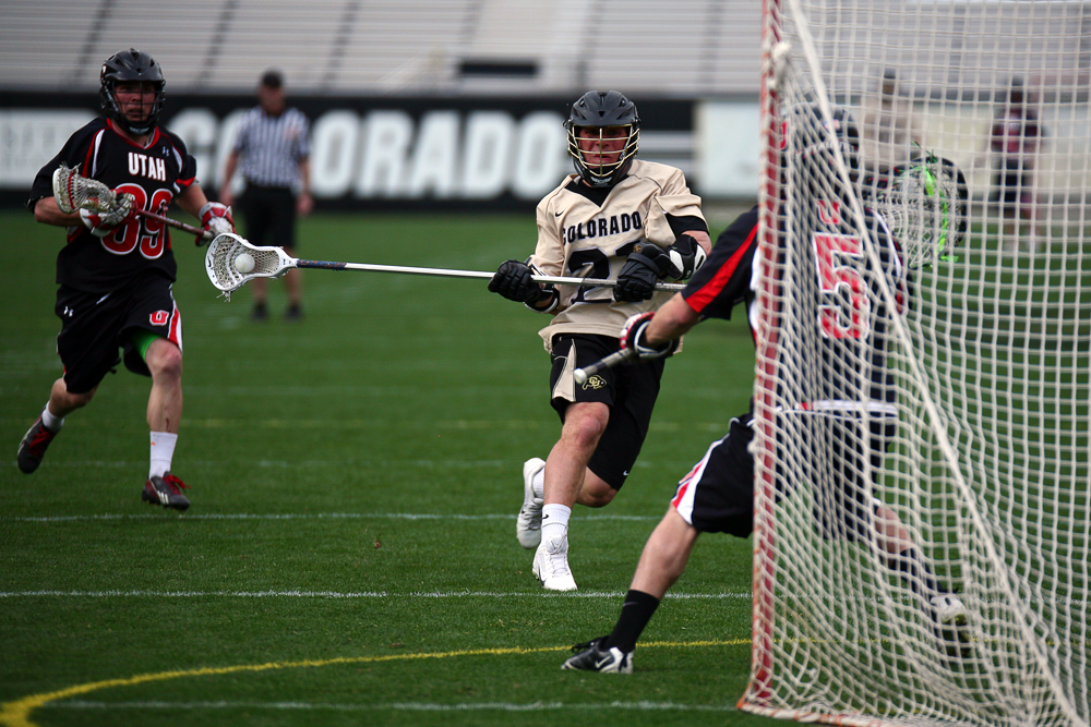 Colorado's Clark Salamie (21) shoots on goal during a men's club lacrosse game between No. 2, Colorado, and Utah, Saturday, at Folsom Field in Boulder, Colo. (Kai Casey/CU Independent)