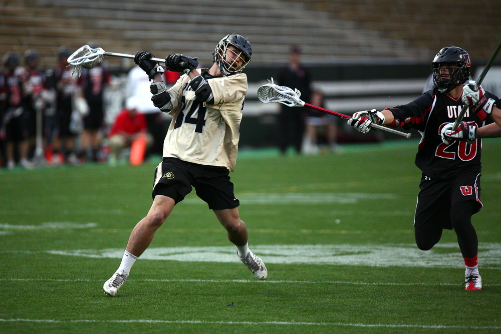 Chris Boland (34) shoots on goal during a men's club lacrosse game between No. 2 Colorado and Utah April 12, 2014, at Folsom Field in Boulder, Colo. (Kai Casey/CU Independent)
