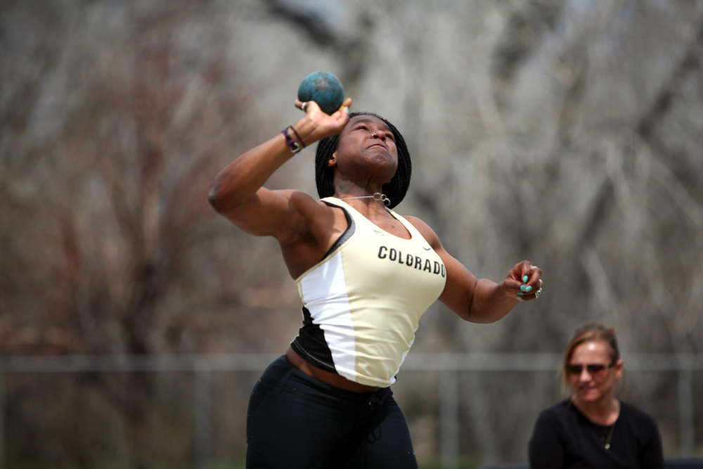 Abrianna Torres of Colorado throws the shot, while competing in the women's shot put during the Colorado Invitational Track and Field Meet, Saturday, at Potts Field in Boulder, Colo. (Kai Casey/CU Independent)