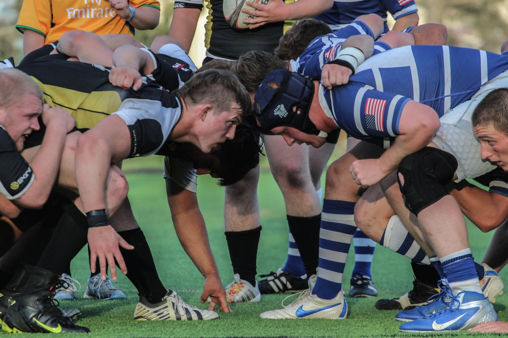 The CU and Airforce rugby teams engage in a scrum on April 15, 2014.  CU lost it's season finale (Matt Sisneros/CU Independent)