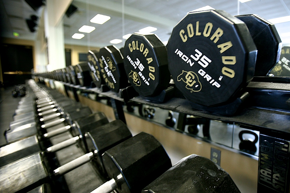 A line of weights inside a weight room in Dal Ward Athletic Center. (Nate Bruzdzinski/CU Independent)