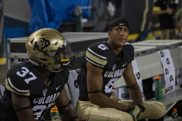 Freshman defensive back, Evan White, and senior linebacker, Woodson Greer III, watch the final seconds tick away and confirm a 31-17 Buffs loss. (Matt Sisneros/CU Independent)