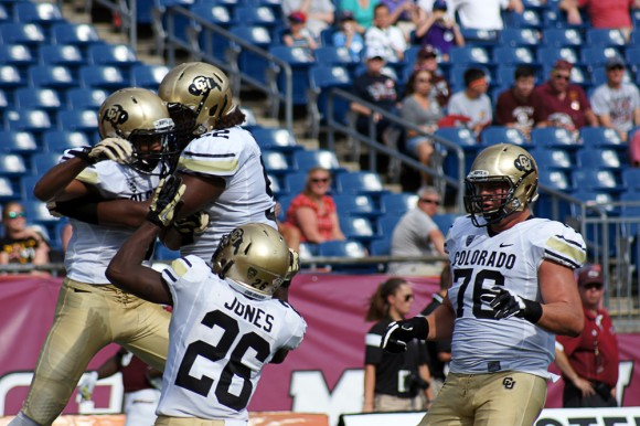 Freshman wide receiver Shay Fields (5) celebrates with teammates Tony Jones (26) and Daniel Munyer (52) after his touchdown on Saturday against UMass. (Photo Courtesy of Cade Belisle/Massachusetts Daily Collegian)