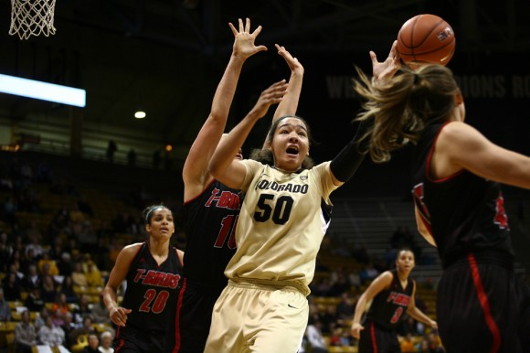 Colorado forward Jamee Swan (50) tries to control the ball while being defended by Southern Utah forward Carli Moreland (15) during an NCAA women's basketball game between Colorado and Southern Utah, Sunday, Dec. 29, 2013, at the Coors Events Center in Boulder, Colo. Swan will have to step up this season after the loss of star forward Arielle Roberson. (Kai Casey/CU Independent)