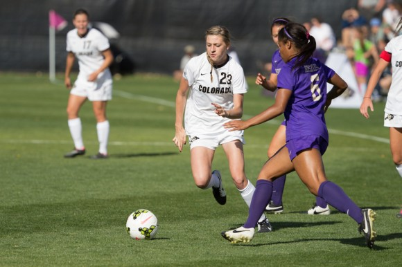 Freshman forward Brittney Stark races  a Washington defender to a loose ball on Sunday. (Matt Sisneros/CU Independent)