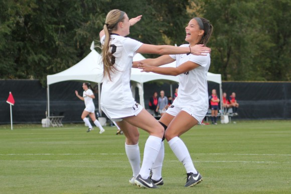 Junior midfielder Olivia Pappalardo runs to embrace freshman forward Brittney Stark. Stark had just scored the second goal of the game against Arizona, giving the Buffs a one-goal lead. (Jade Lang/CU Independent)