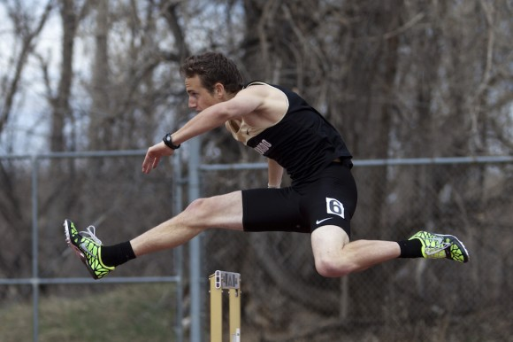 Kyle MacIntosh runs in the 400-meter hurdles at Potts Field in Boulder, Colo. MacIntosh finished first with a time of 52.81 seconds. (CU Independent/Robert R. Denton)