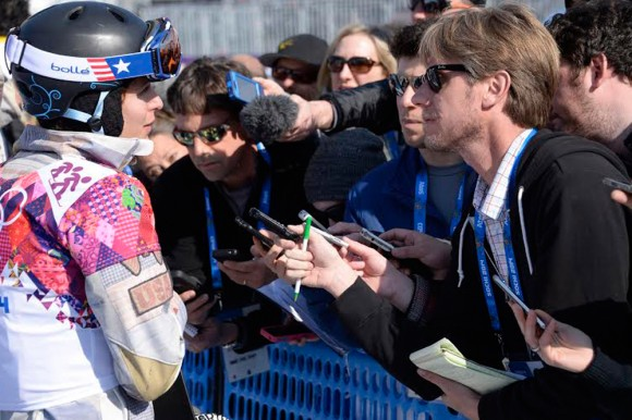 New York Times reporter John Branch interviews US snowboarder Lindsey Jacobellis after an event during the Sochi Olympics in 2014. (Photo Courtesy of Doug Mills/New York Times)