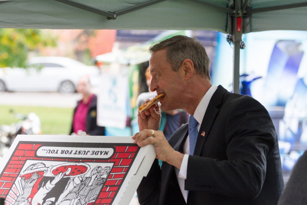 Martin O'Malley, democratic presidential candidate, enjoys a slice of pizza before an interview with Be Heard TV outside of the UMC. October 28th, 2015. (Will McKay/CU Independent)