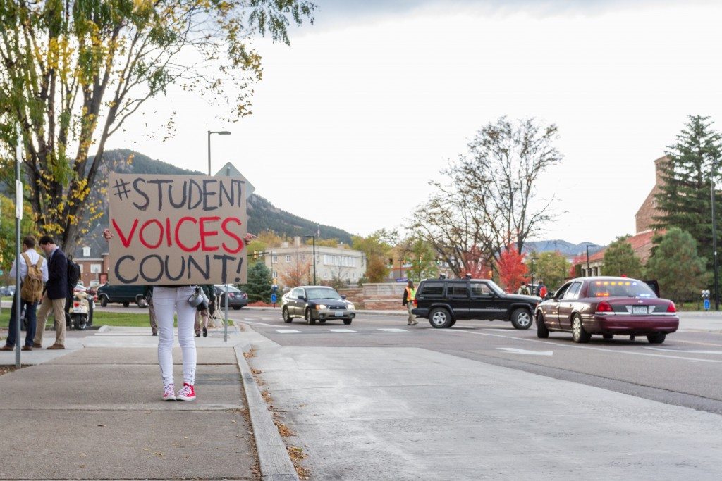 A protester promotes the Student Voices Count group at the Martin O'Malley interview outside of the UMC on October 28th, 2015. (Will McKay/CU Independent)