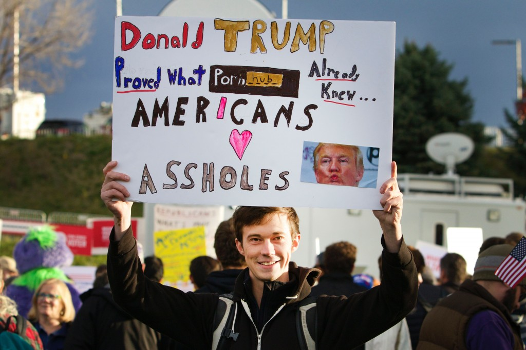 John Kelly, a CU teaching assistant, walks around the free speech area displaying his perspective on Donald Trump's incentives on October 28, 2015. (Emma Pion-Berlin CU Independent)
