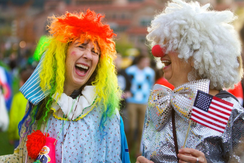 Locals dress up in clown costumes on October 28, 2015 to mock the GOP candidates on the business field. (Emma Pion-Berlin CU Independent)