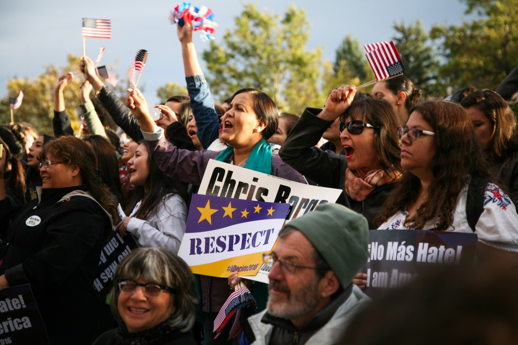 People cheer and shout during the speeches at the immigration rally on Farrand Field before the GOP debate in Boulder Wednesday night. (Danny Anderson/CU Independent)
