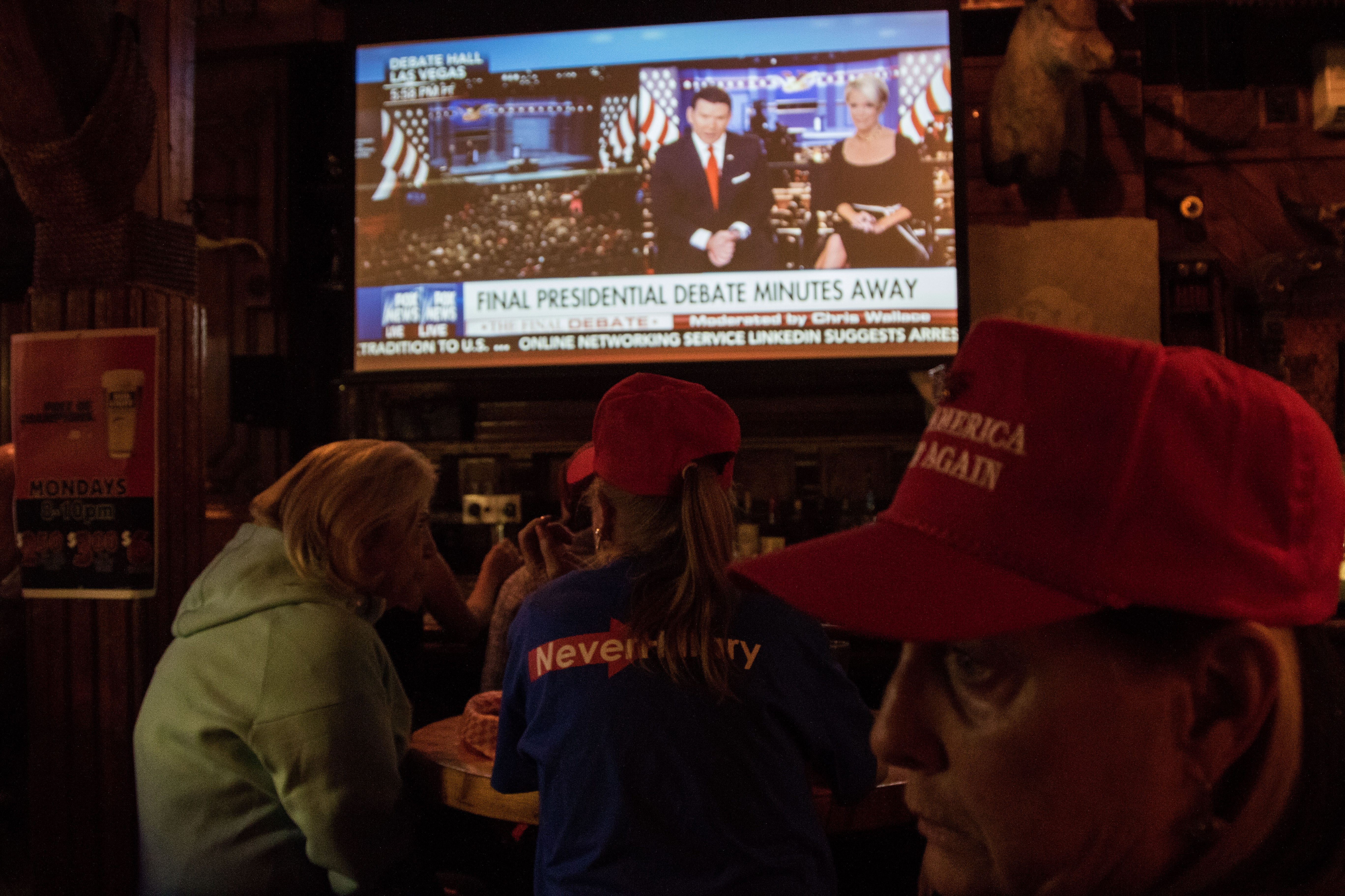 Before the final debate Trump supporters gather together to watch at the Dark Horse. The Dark Horse became their hide out, while many political gatherings happened across Boulder in support of Hillary only a few, hard core supporters met in public at this classic American bar and grill.(Jackson Barnett/CU Independent)