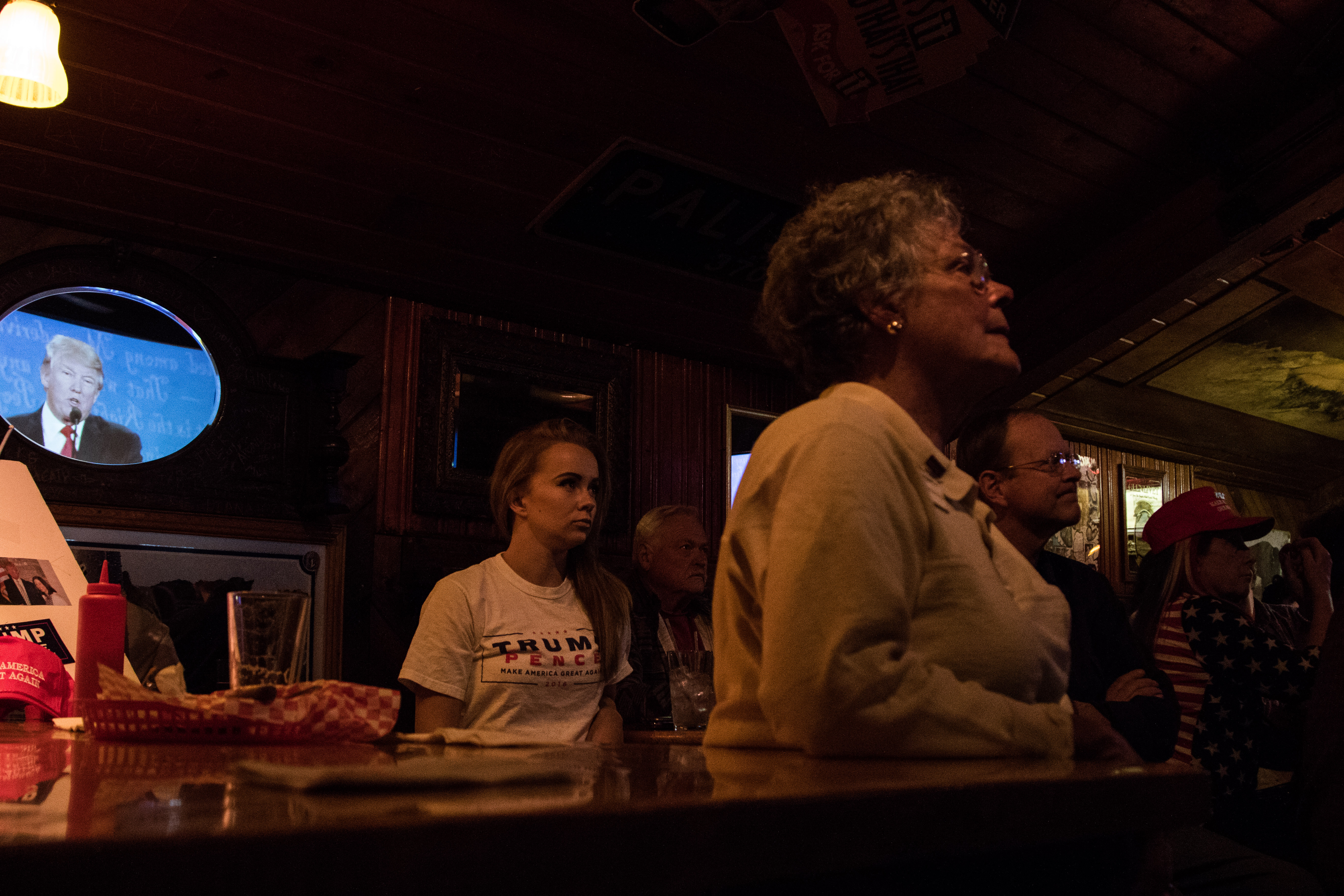 Emily (back left) watched Trump in the final debate in Las Vegas. She is political science graduate and Trump campaign coordinating chairwoman for Boulder county. Only a few students attended the Dark Horse events, but Emily consistently was there in her Trump Pence shirt. (Jackson Barnett/CU Independent)