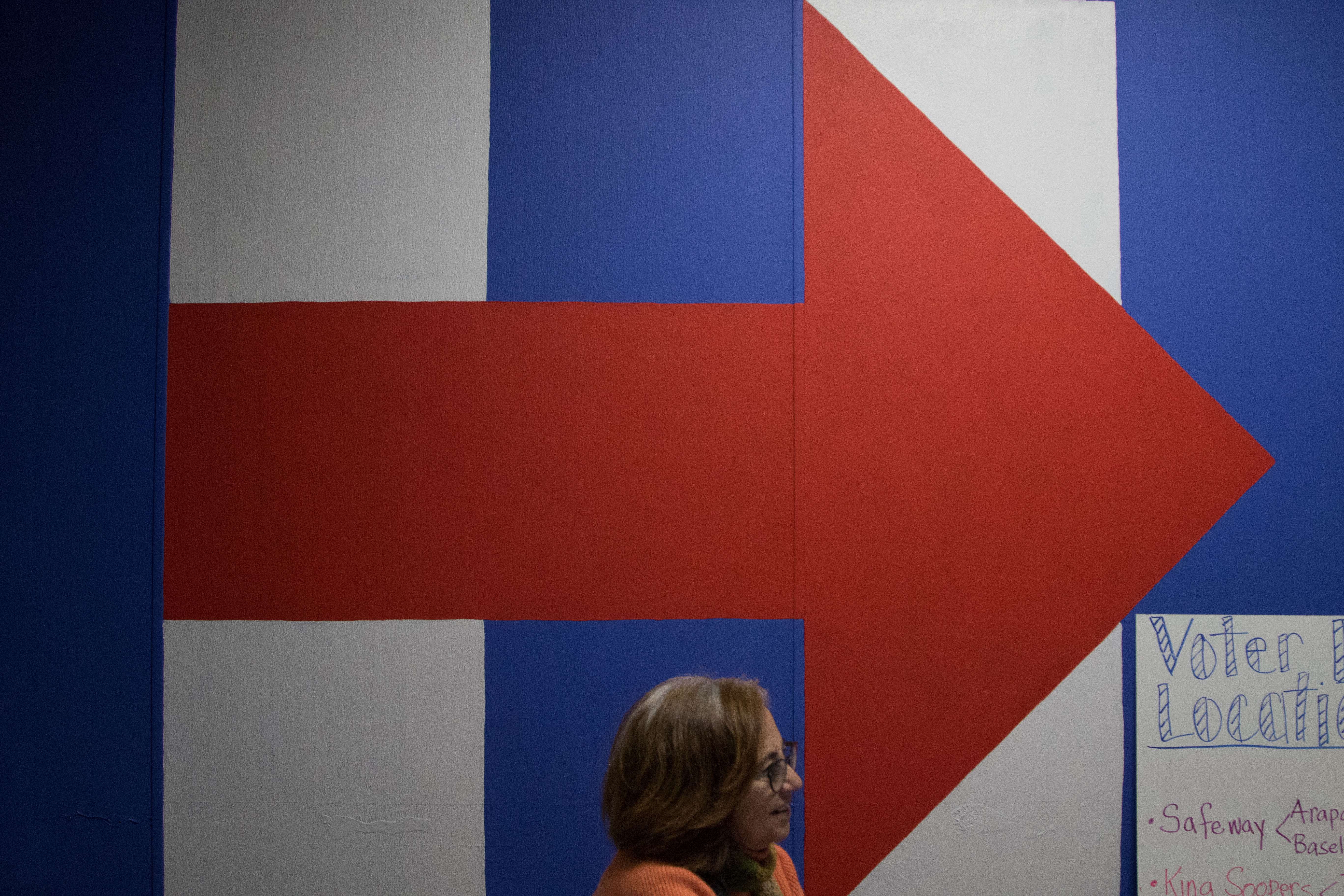 During the Vice Presidential debate a woman sits at the front desk of the Hillary campaign's office. She greets new comers to the office and helps people, esspecially students, register to vote and volunteer. (Jackson Barnett/CU Independent)
