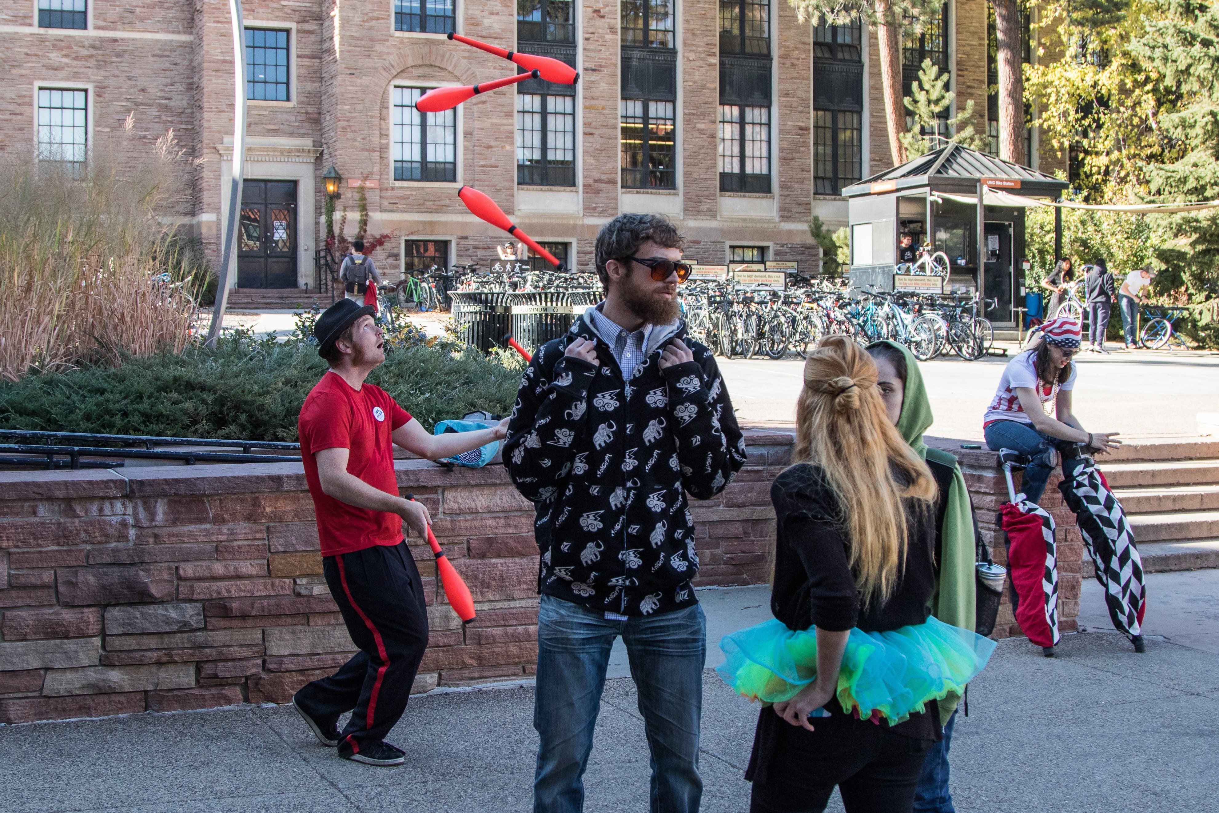 A juggler and stilt walker encourage voting while a representative, Ceely (center in tutu) tells students how to cast their ballot. Nov. 7, 2016 (Jackson Barnett/CU Independent)