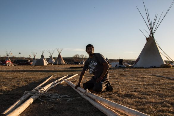 Photos: How to build a teepee at DAPL