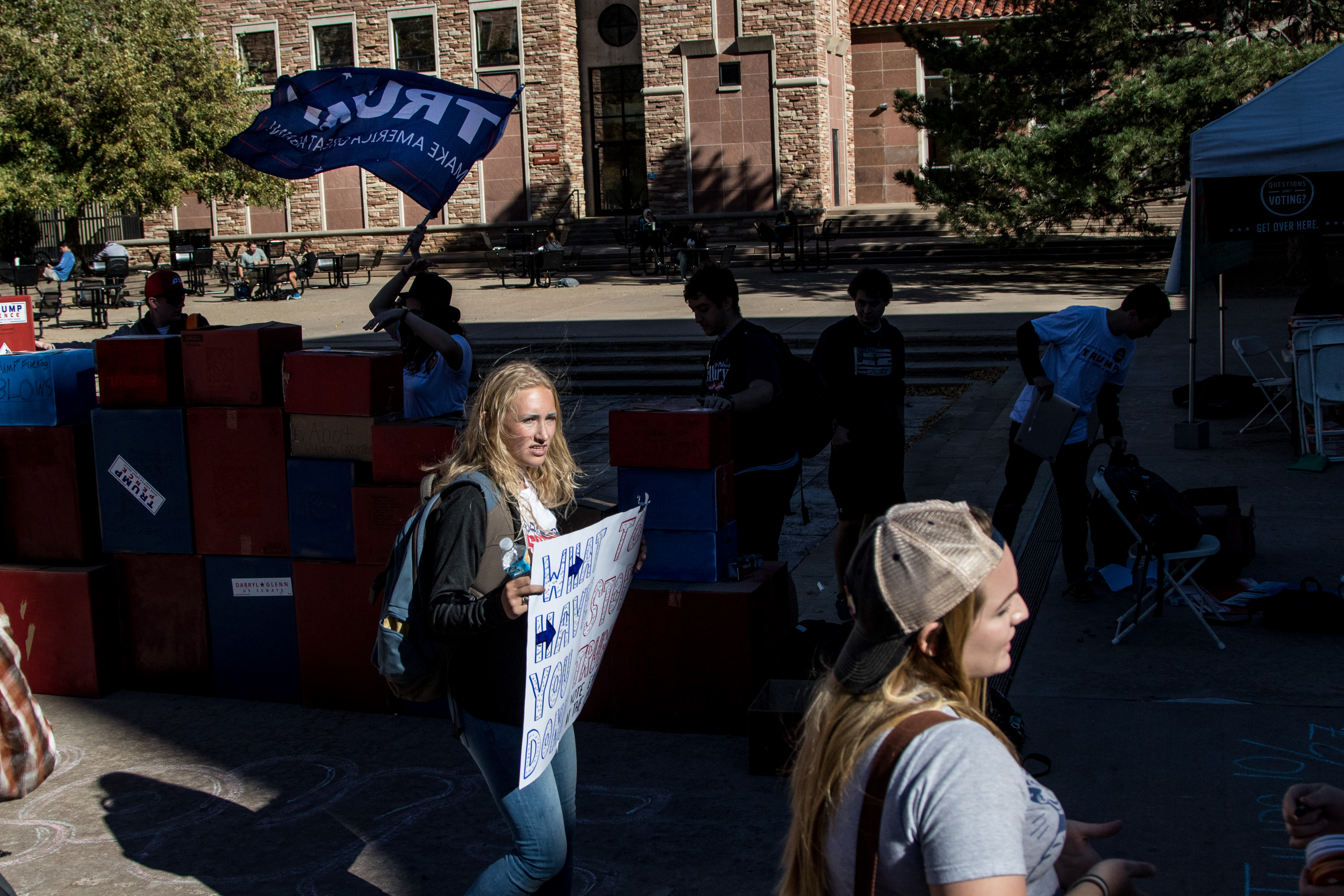 Standing tall late into the day, Sage continues to protest the Trump supporters. Her screams shared her thoughts on Trump's sexual scandals and policies towards women. Her passion was met with laughter and sneers from some students, while others cheered her on. (Jackson Barnett/CU Independent)