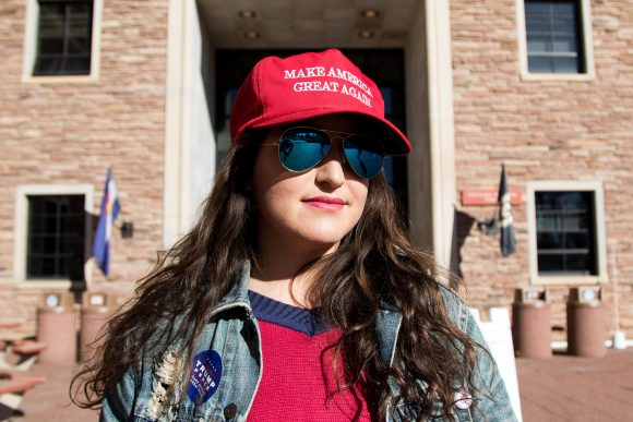 Vanessa waits to speak with voters outside of the 100 foot electioneering boundary. (Jackson Barnett/CU Independent)