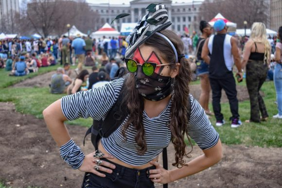 An attendee poses while maintaining her anonymity behind various facial accessories.