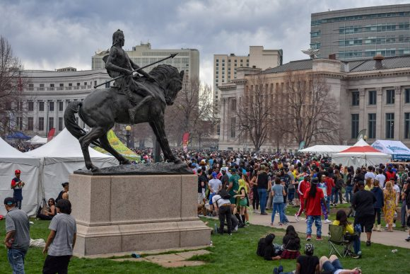 Civic Center statue of a Native American man on a horse amidst Mile High Festival 2019.