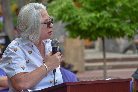 Out Boulder County Executive Director Mardi Moore speaking at Rainbows Over Pearl.