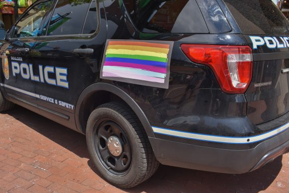 Boulder Police car displays Pride flag on its side, along with the colors of the transgender flag.