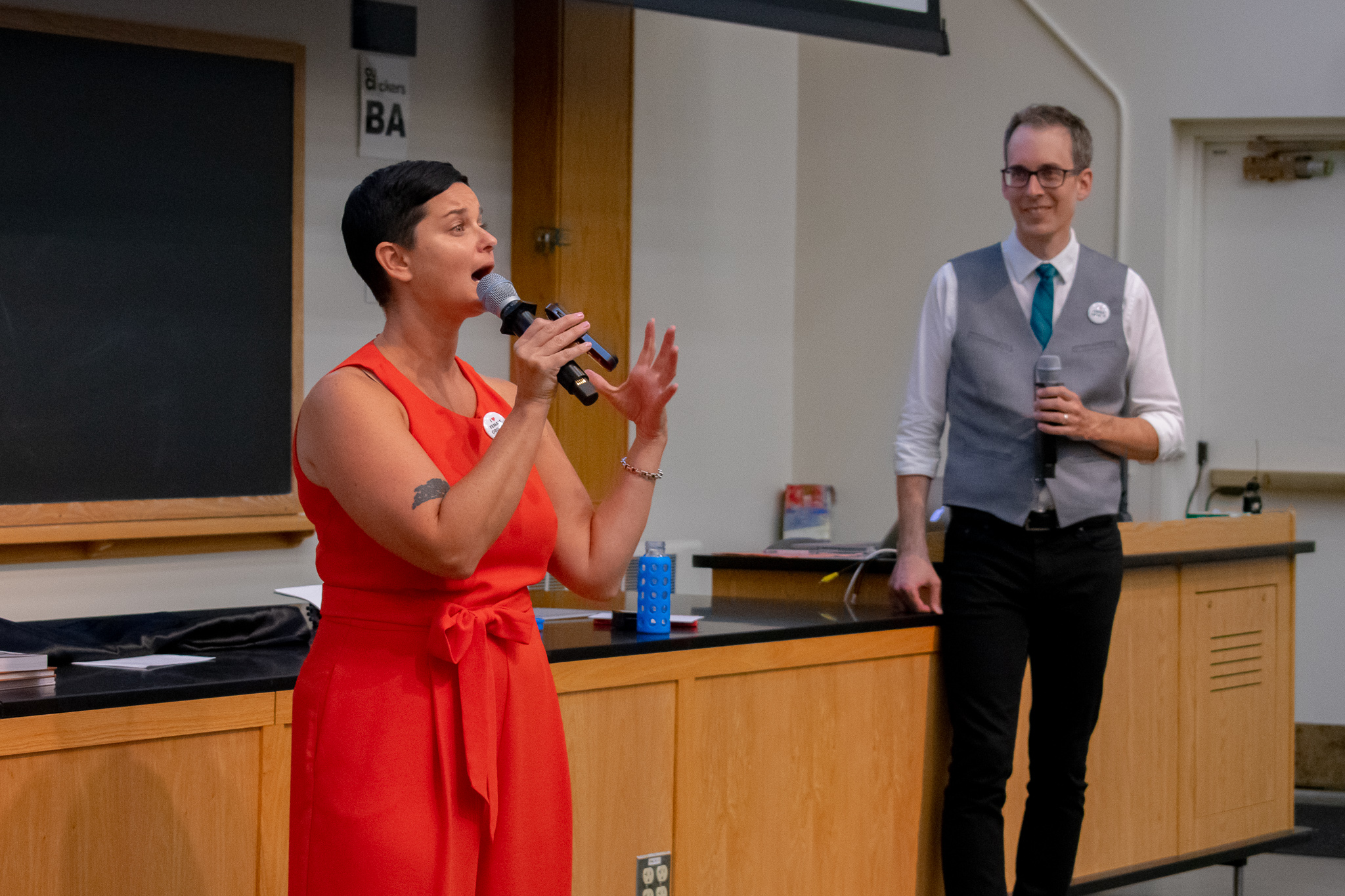 Sex educator Lindsay Fram speaks about her own experiences with sex while fellow sex educator Marshall Miller listens.